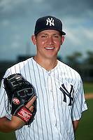 GCL Yankees 2 pitcher Jeffrey Degano (87) poses for a photo before the second game of a doubleheader against the GCL Pirates on July 31, 2015 at the Pirate City in Bradenton, Florida.  The game was suspended after two innings due to rain.  (Mike Janes/Four Seam Images)