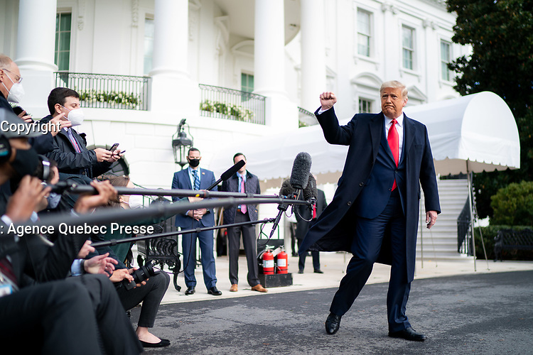 President Trump Boards Marine One<br /> <br /> President Donald J. Trump gives a fist bump to the press Friday, Oct. 30, 2020, prior to boarding Marine One en route to Joint Base Andrews, Md. to begin his trip to Michigan, Wisconsin and Minnesota. (Official White House Photo by Tia Dufour)