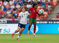 HOUSTON, TX - JUNE 10: Lindsey Horan #9 of the USWNT defends Diana Silva #16 of Portugal during a game between Portugal and USWNT at BBVA Stadium on June 10, 2021 in Houston, Texas.