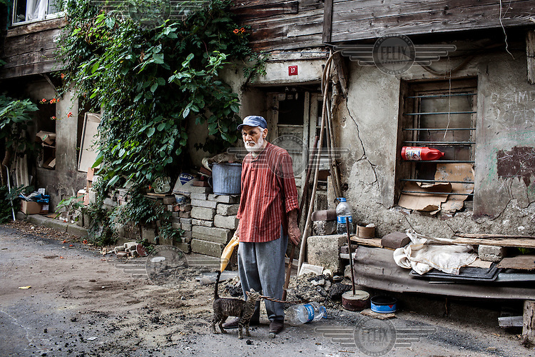 Ismet Hezer outside his old home in Tokludede which is being redeveloped and the locals bought out. Ismet is the last remaining resident and has fought to keep his old home, refusing to leave. During his time fighting the government Ismet tried to commit suicide by drinking pesticide. Although he survided he now has chronic health problems.