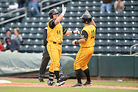 Jacksonville Suns  first baseman Rich Poythress (44) high fives catcher J.T. Realmuto (11) after his game winning single during a game against the Pensacola Blue Wahoos on April 20, 2014 at Bragan Field in Jacksonville, Florida.  Jacksonville defeated Pensacola 5-4.  (Mike Janes/Four Seam Images)
