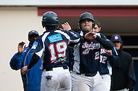 23 October 2010: Vincent Ferreira of Savigny celebrates with Romain Scott-Martinez during Savigny 8-7 win (in 12 innings) over Rouen, during game 3 of the French championship finals, in Rouen, France.