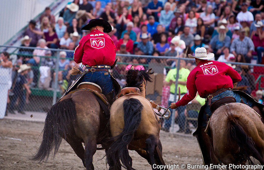 Pickup men at work in the second perf at the Northwest Montana Fair and  Rodeo Kalispell MT August 17th, 2018.  Photo by Josh Homer/Burning Ember Photography.  Photo credit must be given on all uses.