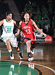 Arkansas State Red Wolves guard Quinishia McDowell (13) drives past North Texas Mean Green guard Denetra Kellum (32) during the NCAA Women's basketball game between the Arkansas State Red Wolves and the University of North Texas Mean Green at the North Texas Coliseum,the Super Pit, in Denton, Texas. Arkansas State defeated UNT 62 to 59