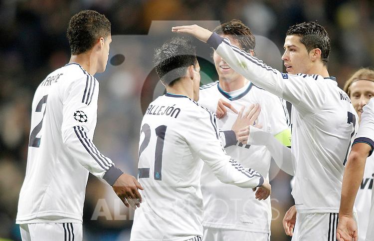 Real Madrid's Jose Callejon celebrates with Cristiano Ronaldo during Champions League Match. December 04, 2012. (ALTERPHOTOS/Alvaro Hernandez)