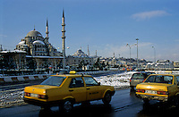 Taxis driving past Suleymaniye Mosque, an Ottoman imperial mosque in Istanbul, Turkey.