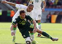 Valter Birsa of Slovenia is tackled by Madjid Bougherra of Algeria
