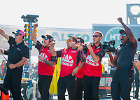 Oct 14, 2019; Concord, NC, USA; Crew members for NHRA top fuel driver Doug Kalitta celebrate a round win during the Carolina Nationals at zMax Dragway. Mandatory Credit: Mark J. Rebilas-USA TODAY Sports