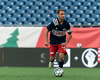 FOXBOROUGH, MA - JULY 23: Jake Rozhansky #32 of New England Revolution II brings the ball forward during a game between Toronto FC II and New England Revolution II at Gillette Stadium on July 23, 2021 in Foxborough, Massachusetts.