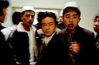 CHINA. Beijing. Men in Niu Jie Mosque during the festival of Eid-al-Fitr, marking the end of Ramadan. 2005