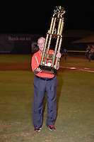 Appalachian League President Lee Landers brings the Championship Trophy to the field  after Game Two of the Appalachian League Championship series against the Burlington Royals at TVA Credit Union Ballpark on September 7, 2016 in Johnson City, Tennessee. The Cardinals defeated the Royals 11-6 to win the series 2-0.. (Tony Farlow/Four Seam Images)