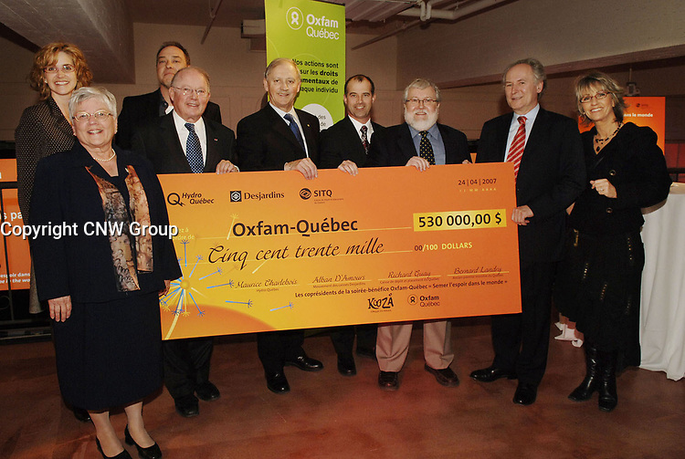 KOOZA – Cirque du Soleil Benefit Evening Raises $530,000 for Sustainable Development Projects. Front : Nicole Saint-Martin, Chair of the Board of Directors, Oxfam-Québec; Bernard Landry, Former Premier of Quebec and Co-chair of event; Alban D'Amours, President and Chief Executive Officer, Desjardins Group and Co-chair of event; Richard Guay, chief Investment Officer, Caisse de dépôt et placement du Québec and Co-Chair of event; Pierre Véronneau, Executive Director, Oxfam-Québec; Maurice Charlebois, Executive Vice President, Human Resources and Shared Services, Hydro-Québec and Co-Chair of event; Judi Richards, Ambassador, Oxfam-Québec. Back : Sylvie Fréchette, Ambassador, Oxfam-Québec; Gil Favreau, Director, Social Action and Responsability, Cirque du Soleil. (CNW Group/Oxfam-Québec)