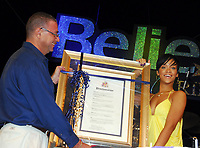 Barbados' Prime Minister, Rt. Hon. David Thompson presents Grammy award winner Rihanna with the official proclamation as Ambassador of Culture and Youth for Barbados in Independence Square, Bridgetown, Barbados, last night. (CNW Group/Barbados Tourism Authority)