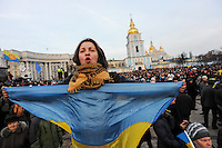A protester seen after the violent assault on main square, Kiev. People that have been dispersed regather in the nearby Mykhailiv monastery square for protests.
