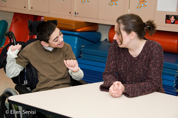 MR / Albany, NY.Langan School at Center for Disability Services .Ungraded private school which serves individuals with multiple disabilities.Child and speech language pathologist interact. Boy: 11, cerebral palsy, expressive and receptive language delays.MR: Bro12; Dub1.© Ellen B. Senisi