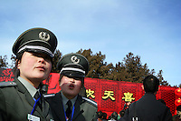 CHINA. Security guards during Chinese New Year in Ditan Park in Beijing.  Chinese New Year, or Spring Festival, is the most important festival and holiday in the Chinese calendar In mainland China, many people use this holiday to visit family and friends and also visit local temples to offer prayers to their ancestors. The roots of Chinese New Year lie in combined influences from Buddhism, Taoism, Confucianism, and folk religions.  2008.