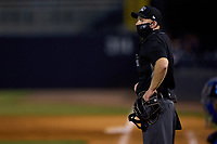 Umpire Austin Nelson, who is wearing a phone with the Automatic Ball-Strike System technology, during a game between the Dunedin Blue Jays and Tampa Tarpons on May 7, 2021 at George M. Steinbrenner Field in Tampa, Florida.  (Mike Janes/Four Seam Images)