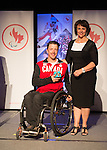 Calgary, AB - June 5 2014 - Josh Dueck receives his Paralympic Ring from Helen Larway, of Air Canada, during the Celebration of Excellence Paralympic Ring Reception in Calgary. (Photo: Matthew Murnaghan/Canadian Paralympic Committee)