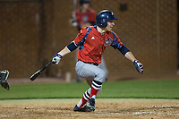Jesse Uttendorfer (2) of the NJIT Highlanders follows through on his swing against the High Point Panthers during game two of a double-header at Williard Stadium on February 18, 2017 in High Point, North Carolina.  The Highlanders defeated the Panthers 4-2.  (Brian Westerholt/Four Seam Images)