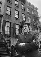 NYC, Manhattan, April 1971 - Eccentric and controversial ghost hunter Hans Holzer gives a tour of well-known haunted houses in Manhattan, including Peter Stuyvesant church, on Second Avenue and 10th street. Mr. Holzer was an American paranormal researcher and author. He wrote over 100 books on supernatural and occult subjects for the popular market as well as several plays, musicals, films and documentaries.