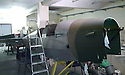 """13/03/15<br /> <br /> **Collect Photo - Best Quality Available**<br /> <br /> Tiger Moth EM-720 being restored in Doncaster.<br /> <br /> ***FULL STORY HERE:   http://www.fstoppress.com/articles/tiger-moth-restorations/    ****<br /> <br /> You may remember spending hours toiling over Airfix models, painstakingly following intricate instructions and trying not to glue your fingers together before painting your own miniature version of one of the RAF's or Luftwaffe's finest aircraft. Then spare a thought for one man who has just helped to restore and put together one World War Two Tiger Moth and is about to start piecing together another FOUR aircraft that were discovered in bits in a barn.<br /> Sixty-year-old Colin Temple-Smith – who wears a moustache that any Wing Commander would be proud of – has spent a lifetime restoring vintage cars and motorcycles and recently quit his job as a window fitter to help re-build the five bi-planes that will become part of a growing fleet of Tiger Moths at Derbyshire based Blue Eye Aviation.<br /> <br /> Today saw the first of the fully-restored five aircraft take to the skies.<br /> <br /> """"It's just like working on old bikes and cars, although they're a lot more fragile"""" explained Colin, whose wife runs the Aviators Café at Darley Moor Airfield near Ashbourne.<br /> <br /> """"When I was a teenager I used to be a member of a modelling club, making flying models from wood and canvas. They're very similar to build – it's really just the size that's changed with these.<br /> <br /> All Rights Reserved: F Stop Press Ltd. +44(0)1335 418629   www.fstoppress.com."""