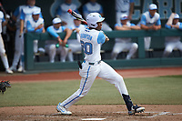 Justice Thompson (20) of the North Carolina Tar Heels at bat against the North Carolina State Wolfpack at Boshamer Stadium on March 27, 2021 in Chapel Hill, North Carolina. (Brian Westerholt/Four Seam Images)