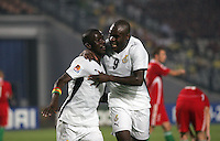Ghana's Abeiku Quansah (7) is hugged by teammate Opoku Agyemang after scoring a goal against Hungary during the FIFA Under 20 World Cup Semi-final match at the Cairo International Stadium in Cairo, Egypt, on October 13, 2009. Costa Rica won the match 1-2 in overtime play. Ghana won the match 3-2.