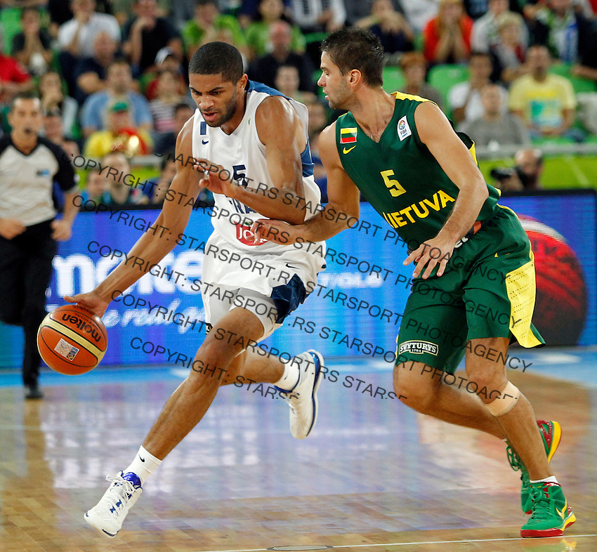 "France`s Nicolas Batum (L) and Mantas Kalnietis of Lithuania (R) in action during European basketball championship ""Eurobasket 2013""  final game between France and Lithuania in Stozice Arena in Ljubljana, Slovenia, on September 22. 2013. (credit: Pedja Milosavljevic  / thepedja@gmail.com / +381641260959)"