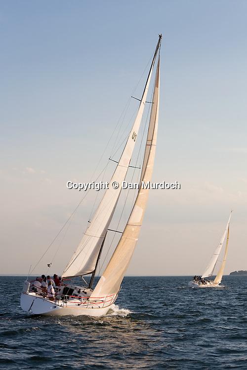 two sailboats making way