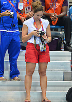 August 04, 2012. Swimmer Nadia Cruz of Angola smiles while reviewing the picture of Michael Phelps she made at the Aquatics Center on day eight of 2012 Olympic Games in London, United Kingdom.