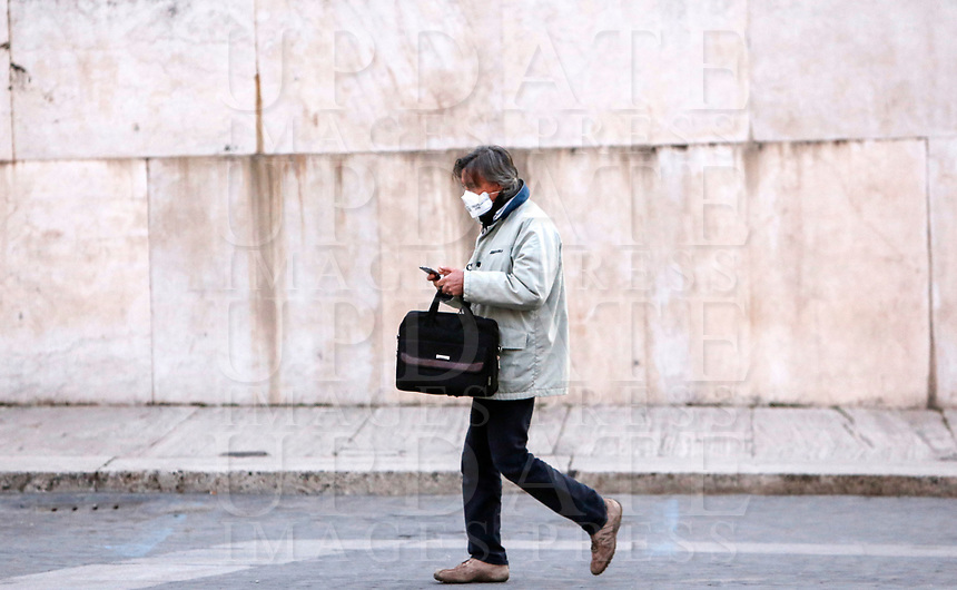 A man wearing a mask to protect herself from the Covid-19 walks in Piazza Venezia, Rome, Italy, March 10, 2020. <br /> UPDATE IMAGES PRESS/Riccardo De Luca