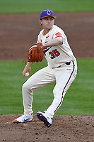 Relief pitcher Ryan Miller (35) of the Clemson Tigers picked up his first win of the season against the Furman Paladins on Tuesday, February 20, 2018, at Doug Kingsmore Stadium in Clemson, South Carolina. Clemson won, 12-4. (Tom Priddy/Four Seam Images)