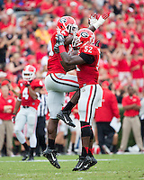 The Georgia Bulldogs played North Texas Mean Green at Sanford Stadium.  After North Texas tied the game at 21 early in the second half, the Georgia Bulldogs went on to score 24 unanswered points to win 45-21.  Georgia Bulldogs linebacker Leonard Floyd (84), Georgia Bulldogs linebacker Amarlo Herrera (52) celebrate after a play.