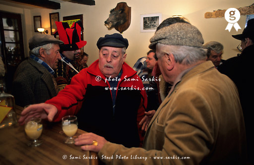 People having a drink inside a coffee shop during the shrove tuesday, Belvedere village, France - Belvedere is a french southern alps village  in the river Vesubie valley  (Licence this image exclusively with Getty: http://www.gettyimages.com/detail/81867408 )