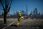 A massive forest fire stoked by strong winds burnt through the southeast of Slave Lake, Alberta on May 16, 2011. Hundreds of homes were reported lost to the fire. Photo by Jimmy Jeong / www.jimmyshoots.com