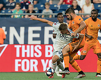 FOXBOROUGH, MA - JUNE 29: Justin Rennicks #12 attempts to control the ball as Alejandro Fuenmayor #2 defends during a game between Houston Dynamo and New England Revolution at Gillette Stadium on June 29, 2019 in Foxborough, Massachusetts.