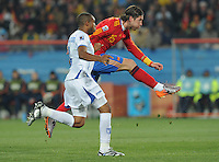 Spanish defender Sergio Ramos dribbles into the attack for a shot on the Honduran goal. Spain defeated Honduras, 2-0, in their second match of play in Group H  in a match played Monday, June 21st, at Ellis Park in Johannesburg, South Africa at the 2010 FIFA World Cup..