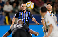 CARSON, CA - SEPTEMBER 21: Rudy Camacho #4 of Montreal Impact stares down a ball during a game between Montreal Impact and Los Angeles Galaxy at Dignity Health Sports Park on September 21, 2019 in Carson, California.