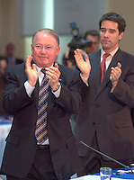 June 6 , 2002, Montreal, Quebec, Canada<br /> <br />  Bernard Landry, Quebec Premier (L) and<br /> Andre Boisclair, Quebec Minister Municipal Affairs,<br /> Quebec Minister Environment applaud (R)<br />  after Gerald Tremblay, Montreal Mayor <br /> speech at  the closing  of the Montreal Summit<br />  (Le Sommet de MontrÈal), June 6, 2002<br /> <br /> <br />  <br /> Mandatory Credit: Photo by Pierre Roussel- Images Distribution. (©) Copyright 2002 by Pierre Roussel <br /> ON SPEC<br /> NOTE l Nikon D-1 jpeg opened with Qimage icc profile, saved in Adobe 1998 RGB.