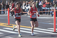 NEW YORK - NOVEMBER 7: Kelly Chin and Stephanie Lenihan of the USA approach the 8 mile mark on 4th avenue in the 2010 New York City Marathon. Lenihan finished 41th in 2:50:50 and Chin 77th in 3:04:00.