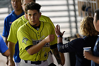 Starting pitcher Jose Butto (45) of the Columbia Fireflies is greeted in the dugout after pitching 5.2 scoreless innings in a game against the Delmarva Shorebirds on Thursday, May 2, 2019, at Segra Park in Columbia, South Carolina. Delmarva won, 1-0. (Tom Priddy/Four Seam Images)