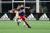 FOXBOROUGH, MA - MAY 22: Matt Polster #8 of New England Revolution attempts to break away from Sean Davis #27 of New York Red Bulls during a game between New York Red Bulls and New England Revolution at Gillette Stadium on May 22, 2021 in Foxborough, Massachusetts.