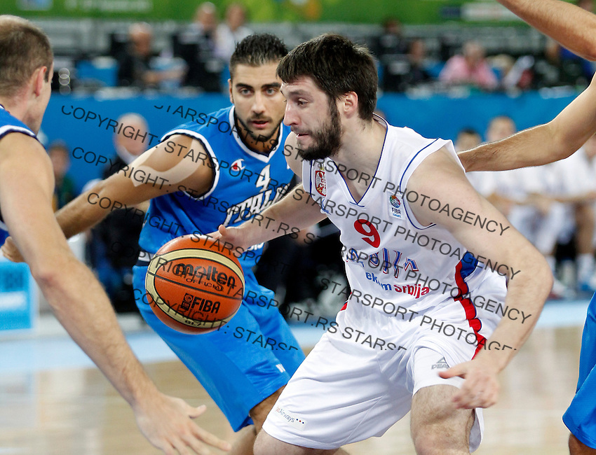 """Stefan Markovic of Serbia in action during European basketball championship """"Eurobasket 2013""""  basketball game for 7th place between Serbia and Italy in Stozice Arena in Ljubljana, Slovenia, on September 21. 2013. (credit: Pedja Milosavljevic  / thepedja@gmail.com / +381641260959)"""
