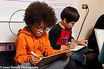 Education K-8 public school Grade 3 math activity using dry erase boards