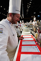 Lyon, 30 January 2019 – The Australian team of Michael Cole (Candidate), Laura Skvor (Commis), Scott Pickett (Coach), and Tom Milligan (President) competing on day two of the 2019 Finale of the Bocuse d'Or held at the Sirha trade show at Eurexpo in Lyon, France. Photo Bocuse d'Or/Pool