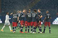 FOXBOROUGH, MA - NOVEMBER 1: Teal Bunbury #10 of New England Revolution celebrates the winning goal with his team mates during a game between D.C. United and New England Revolution at Gillette Stadium on November 1, 2020 in Foxborough, Massachusetts.