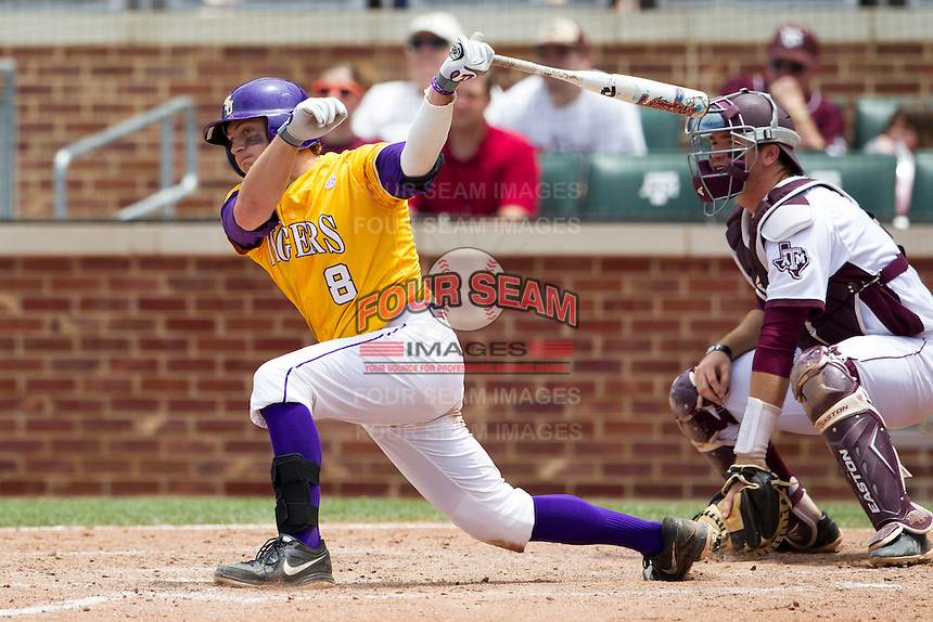 LSU Tigers first baseman Mason Katz (8) follows through on his swing against the Texas A&M Aggies in the NCAA Southeastern Conference baseball game on May 11, 2013 at Blue Bell Park in College Station, Texas. LSU defeated Texas A&M 2-1 in extra innings to capture the SEC West Championship. (Andrew Woolley/Four Seam Images).