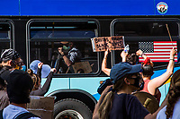 NEW YORK, NEW YORK - JUNE 07: A man raises his arm inside a bus in support of protests in upper Manhattan on June 7, 2020 in New York, NY. Protesters continue to take to the streets of the United States and in other parts of the world after the murder of George Floyd by a white police officer Derek Chauvin. The protests attempt to give voice to the need for African American human rights. (Photo by Pablo Monsalve / VIEWpress )