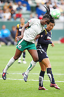 Tina Ellertson #8 of St. Louis Athletica and Han Duan #9 of the Los Angeles Sol battle for control of a loose ball during their WPS game at Home Depot Center on May 30, 2009 in Carson, California. LA Sol defeated  St. Louis Athletic 2-0.