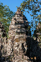 Cambodia.  North Gate, Angkor Thom.  Some say the face is that of King Jayavarman VII, but this is not universally accepted.